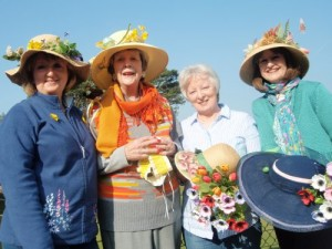 Ladies from Comber Horticulutral Society getting their hats ready for the Easter Bonnet Competition at Comber Farmers' Market on 2 April 2015
